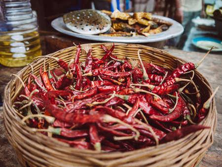 Bangladesh street food - dried red chili pepper in bamboo basket, Asian food ingredient at Dhaka market Stock Photo