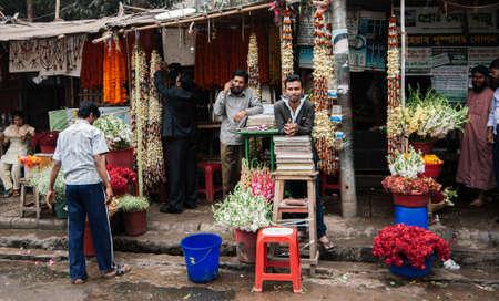 FEB 17, 2012 Dhaka, Bangladesh - Bangladesh people, seller and local flower shop on street side in Dhaka city center