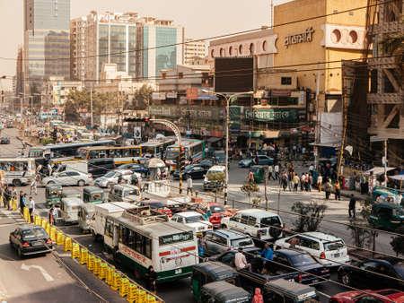 Feb 12, 2012 Dhaka, Bangladesh - Bad Traffic jam with many cars and buses on Dhaka city street with smoke and pollution. Bangladesh Publikacyjne