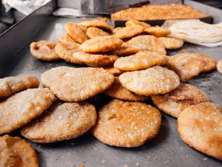 Famous Bangladesh or Indian South Asian street food. Crispy fried bread Puri or Poori.