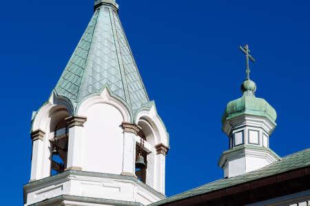 Hakodate Orthodox Church - Russian Orthodox church onion domes bell tower with cross in winter under blue sky. Motomachi - Hakodate, Hakkaido