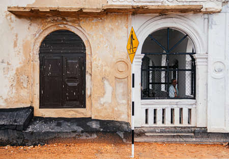 JUL 3, 2012 Galle, Sri Lanka - Galle city old town ruined Dutch colonial buildings wall with local people