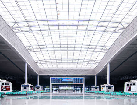 JUL 8, 2010 Changsha, China - Changsha station high speed train station with modern white roof structure high ceiling passenger hall