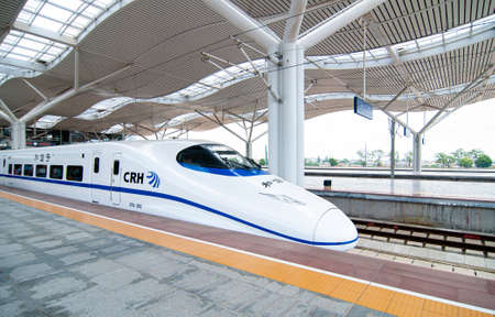 JUL 8, 2010 Changsha, China - China high speed train model CRH2C wait to departure under modern white roof structure of Changsha station