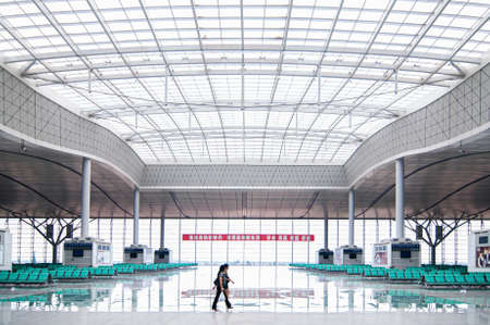 JUL 8, 2010 Changsha, China - Passenger at Changsha station high speed train station with modern white roof structure high ceiling passenger hall