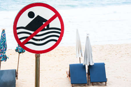 No swimming sign with beach view strong wave and beach beds in Monsoon season
