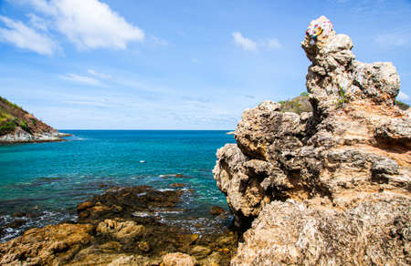 Turquoise blue sea under blue sky with white clouds and rock cliff at Yanui beach in phuket. Thailand