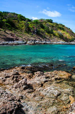 Turquoise blue sea waves and rock shore at Yanui beach in phuket. Thailand