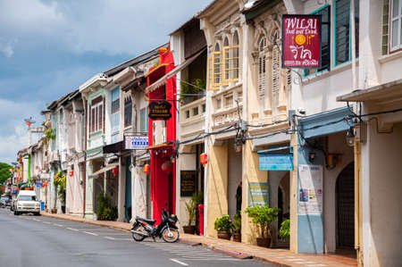 MAY 23, 2020 Phuket, Thailand - Colourful old Phuket Sino Portuguese house with red chinese lanterns hanging from front facade in Phuket Old town area.
