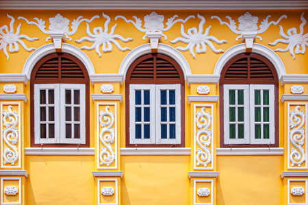 MAY 23, 2020 Phuket, Thailand - Old Phuket colourful Sino Portuguese house classic facade with stuccowork architecture exterior from colonial time in Phuket Old town area. 報道画像