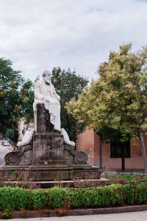 OCT 26, 2012 Barcelona, Spain - Monument of Joan Guell i Ferrer, an industrialist, politician and Spanish economist active advocate of protectionism in La Colonia Guell