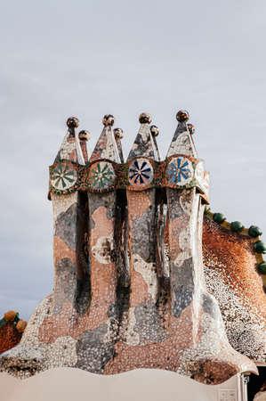 OCT 26, 2012 Barcelona, Spain - Casa batllo extraordinary mansion artisan mosaic decorated chimney was design by Antoni Gaudi, the most famous Spanish architect.
