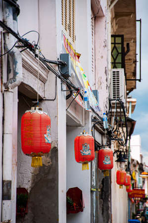 MAY 23, 2020 Phuket, Thailand - Old Phuket Sino Portuguese house with red chinese lanterns hanging from front facade in Phuket Old town area.