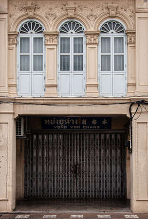 MAY 23, 2020 Phuket, Thailand - Old Phuket Sino Portuguese house classic facade with stuccowork architecture exterior from colonial time in Phuket Old town area.