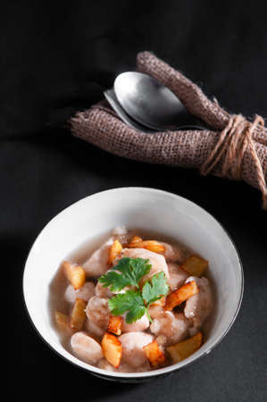 Braised chicken stew with fried potatoes. Modern Chinese recipe with nice table set Фото со стока