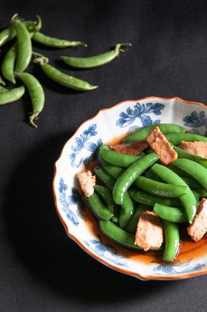 Stir fry gren peas with crunchy frie tofu - Asian cuisine in beautiful ceramic plate