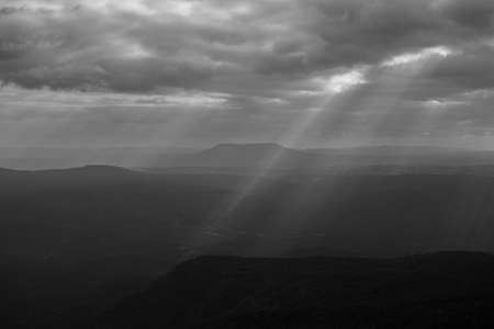 Beautiful charming dramatic sunset sunset sky wide and high mountain landscape Pha Yieb Mek in Phu Kradueng National park. Loei, Thailand.black and white
