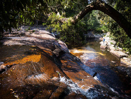 Beautiful water stream of waterfall with tropical tree and stone landscape. Pen Pob waterfall at Phu Kradueng National park, Loei - Thailand. Фото со стока