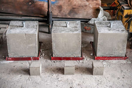 Steel bolt in concrete block cube for concrete strength testing process