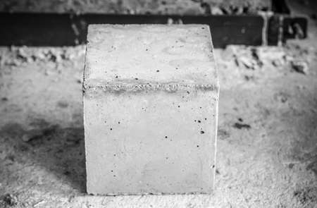 Square concrete block cubes for concrete strength testing process close up detail. black and white