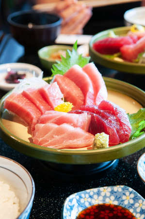Japanese fresh Tuna Sashimi Toro Otoro Maguro Chutoro serving in beautiful Japanese style tray wiith lunch set.