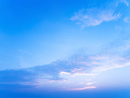 Peaceful serene sea scape and blue tone sunset or sunrise sky with clouds at dawn or dusk