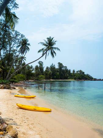 Yellow Kayak boat on tropical island beach white sand under bright sun in summer season. Koh Kood - Thailand Foto de archivo