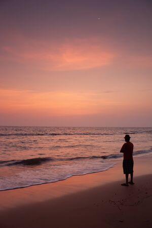 Susnet at Anjuna beach goa with a man on the beach Stock fotó