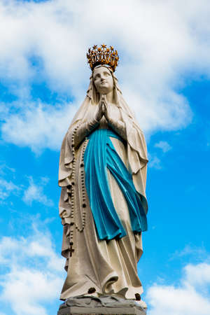 Statue of Our Lady in front of the sky