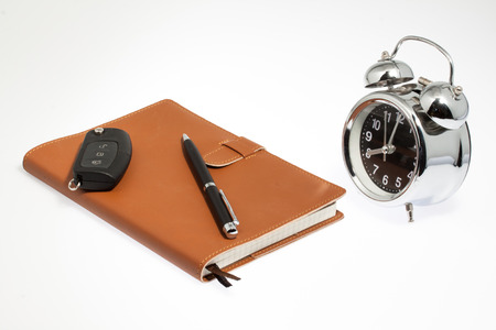 notebook with car key and clock photo