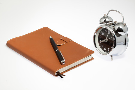 notebook with clock photo