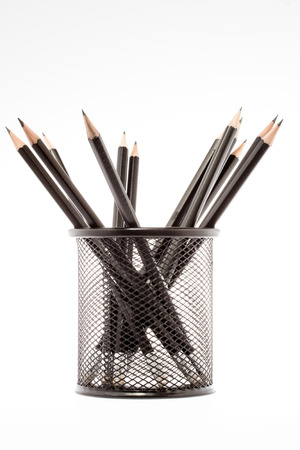 black pencil holder with pencils isolated on white background photo