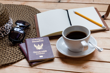 coffee cup with passport and notebook photo