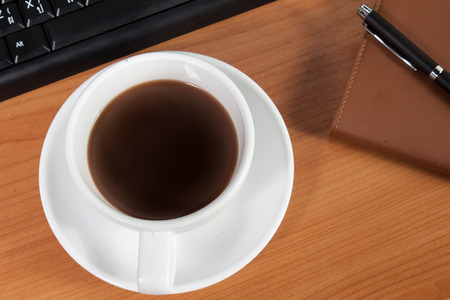 office desk: Office desk with coffee cup Stock Photo
