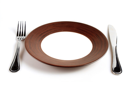 Plates with a silver fork and knife photo