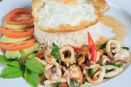 topped: Thai Food Style: Rice topped with stir-fried seafood and basil