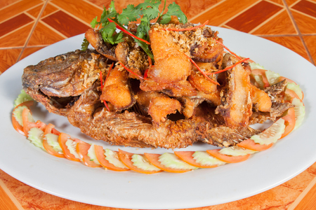 chilli sauce: Thai food style: Fried fish toppted with chilli sauce Stock Photo