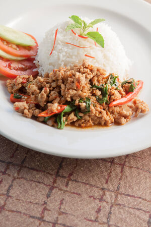 Thai Food Style: Rice topped with stir-fried pork and basil photo
