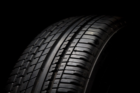 summer tire: Car tires close-up on black background Stock Photo