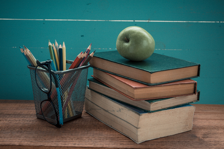 Book with apple and pencil box