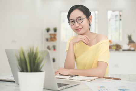 Young Asian Woman Working at home, Young business start up online seller owner,  Delivery Project, Woman with Online Business or SME Concept.