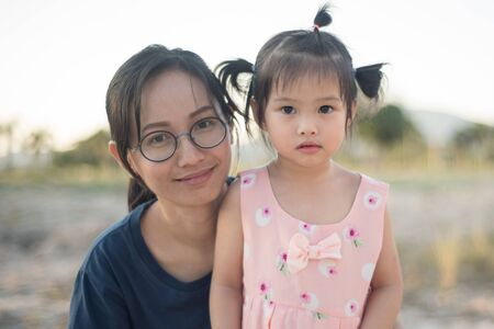 Asian woman and Asian child happiness together. Standard-Bild