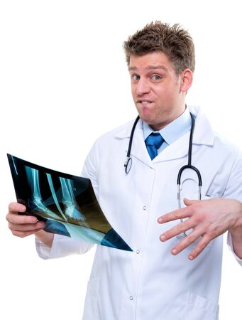 expressive doctor examining an bad x-ray of feet photo
