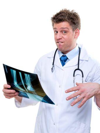 expressive doctor examining an bad x-ray of feet Stock Photo - 17795072