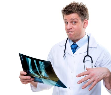 expressive doctor examining an bad x-ray of feet Stock Photo - 17795073