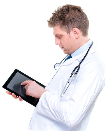 Portrait of handsome male doctor touching digital tablet Stock Photo - 17795002