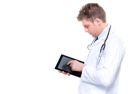 Portrait of handsome male doctor touching digital tablet Stock Photo