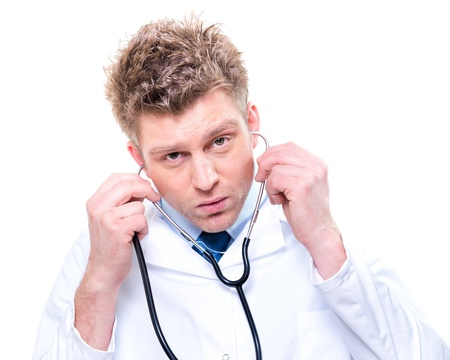 Portrait of handsome doctor listening with a stethoscope  Isolated Stock Photo - 17795019