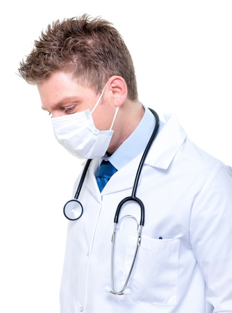 Portrait of handsome male doctor wearing surgical mask Stock Photo - 17795076