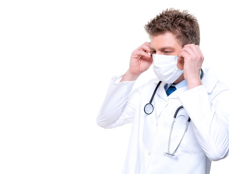 Male nurse or doctor wearing surgical mask and stethoscope